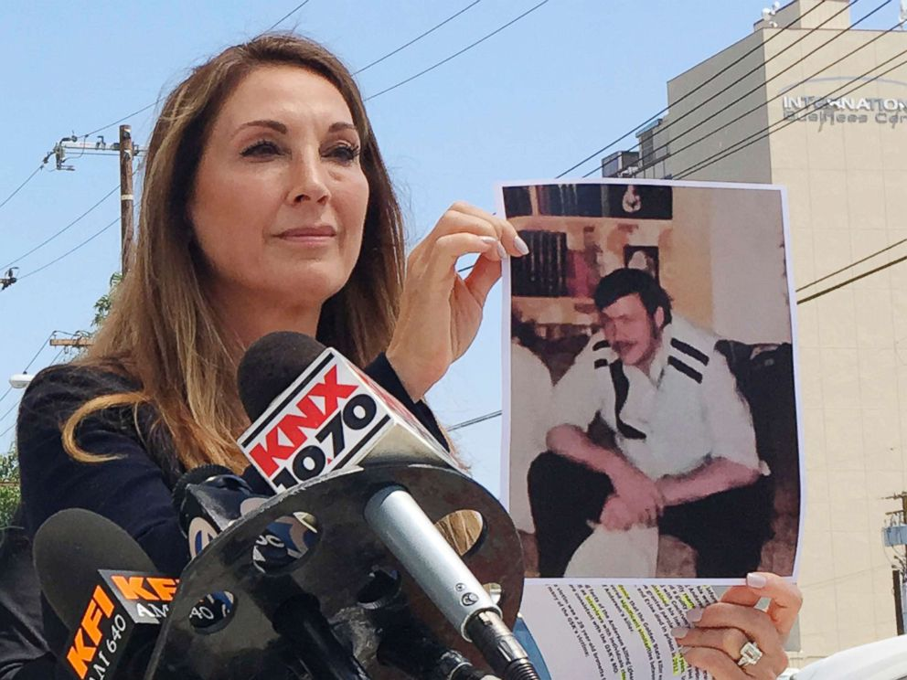 PHOTO: Attorney Annee Della Donna holds a photo of William Evins, now deceased, who was convicted of the murder of a woman in 1979, outside Superior Court in Santa Ana, July 25, 2018.