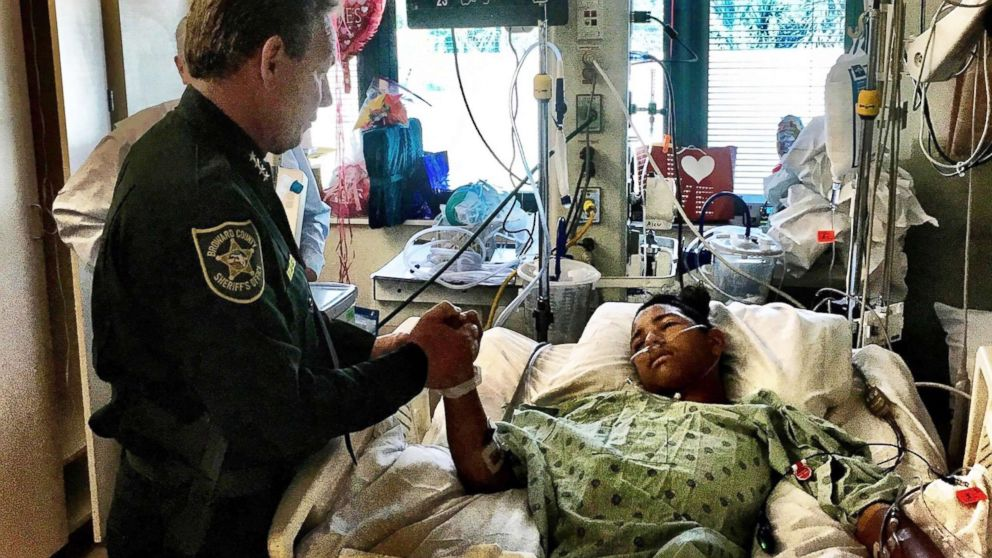 Sheriff Israel of Broward Sheriff's Office visits Anthony Borges, 15, in hospital on Feb. 18, 2018.