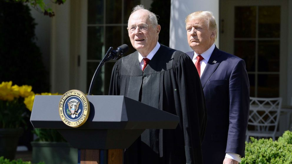 Justice Anthony Kennedy speaks as President Donald trump looks on before Neil Gorsuch is swearing in as an Associate Justice of the Supreme Court during a ceremony at the White House Rose Garden, April 10, 2017, in Washington.