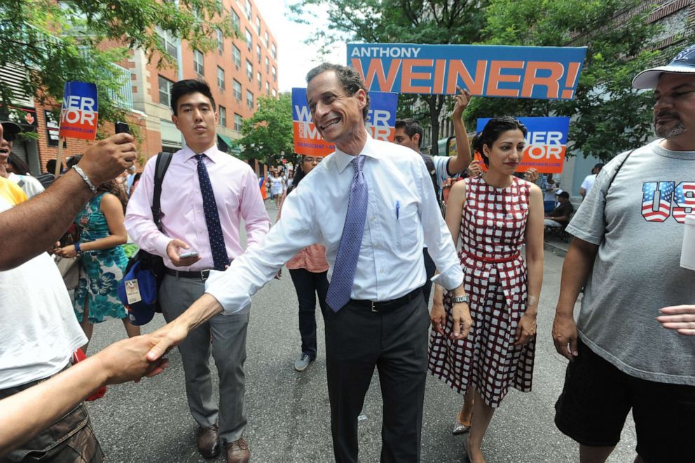 PHOTO: Mayorial candidate Anthony Weiner and his wife Huma Abedin campaign on W. 111 St. in New York, July 14, 2013.