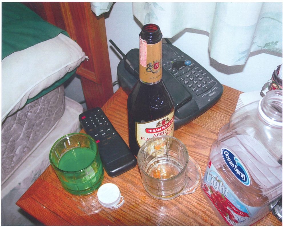 Police found a glass of green liquid on the bedside table next to where David Castor was found dead.