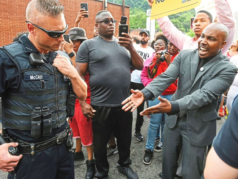 PHOTO: Leonard Hammonds II, of Penn Hills, right, points out that a Turtle Creek Police officer has his had on his weapon during a rally in East Pittsburgh, Pa., on June 20, 2018, at a protest regarding the shooting death of Antwon Rose.