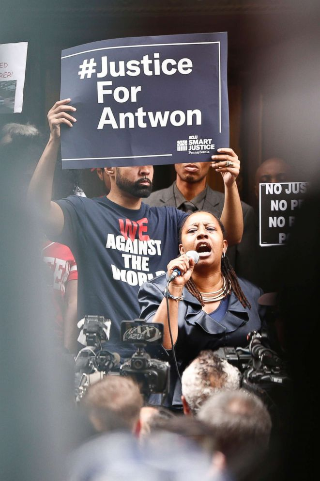 PHOTO: Protesters listen to one of the speakers as they rally in front of the Allegheny County Courthouse, June 21, 2018, in Pittsburgh for the killing of Antwon Rose Jr. who was fatally shot by a police officer.