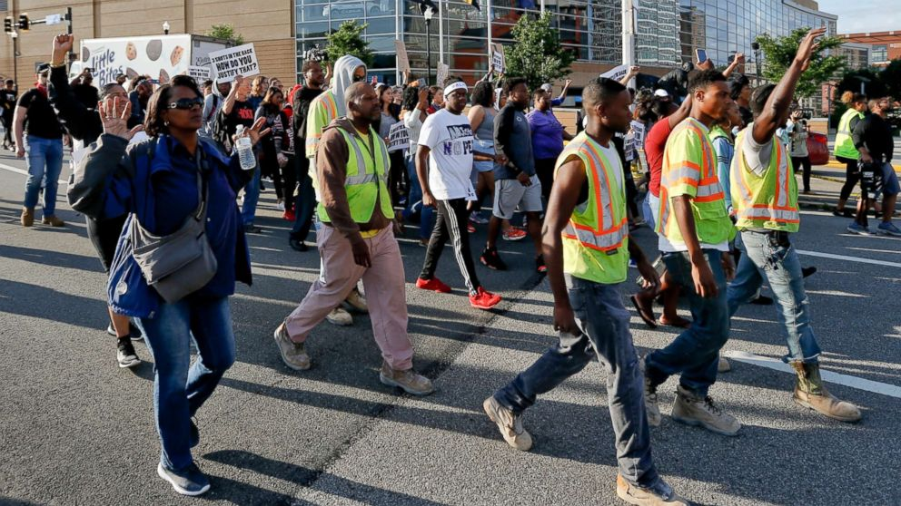 People march to protest the shooting death of Antwon Rose Jr. on June 26, 2018, in Pittsburgh. Rose was fatally shot by a police officer seconds after he fled a traffic stop June 19, in the suburb of East Pittsburgh.