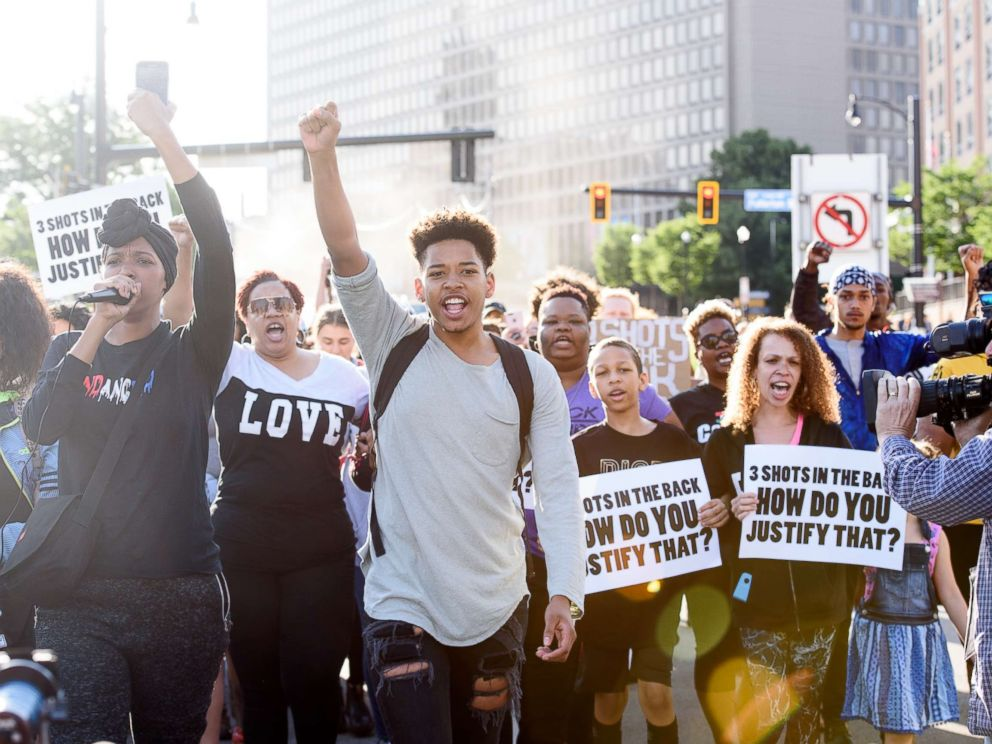 PHOTO: Christian Carter, 18, of East Liberty, Pa., leads protesters a day after the funeral of Antwon Rose II on June 26, 2018 in Pittsburgh.