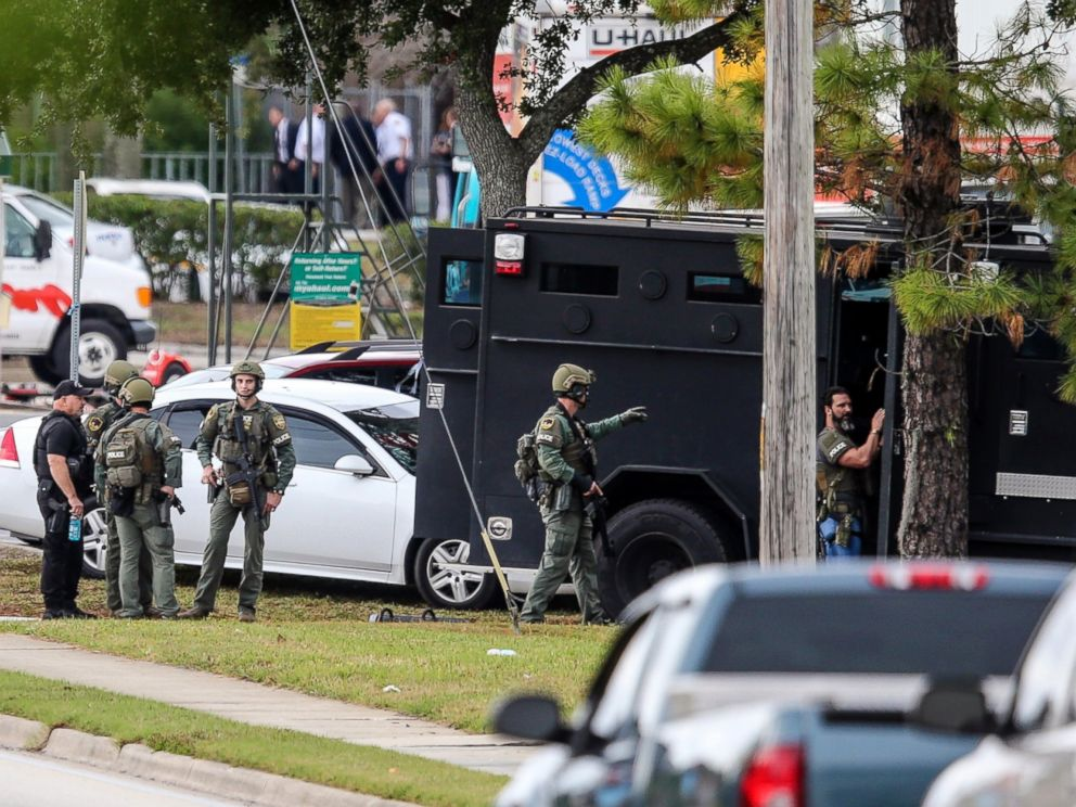 PHOTO: Law enforcement personnel gather near the Community First Credit Union bank, Thursday, Dec. 1, 2016, in Jacksonville, Fla., where authorities say a bank robber was holding several hostages.