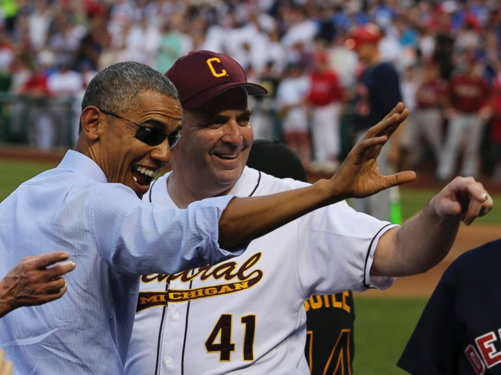 PHOTO: President Barack Obama waves with Representative Dan Kildee, D-Mich (R) during a visit of the 2015 Congressional Baseball Game at the National Parks Stadium, in Washington, D.C., June 11, 2015.