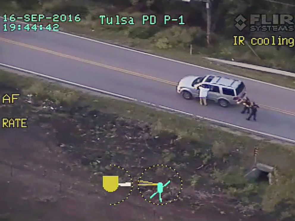 PHOTO: In this Sept. 16, 2016 image made from video provided by police, Terence Crutcher, left, with his arms held up, is pursued by police officers as he walks next to his stalled SUV before he was shot and killed by one of the officers in Tulsa, Okla.