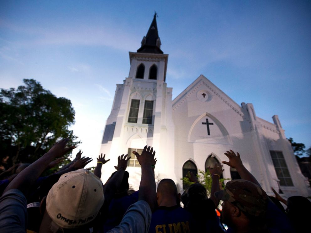 PHOTO: Men from Omega Psi Phi Fraternity Inc. lead a crowd of people in prayer outside the Emanuel AME Church in Charleston, S.C., June 19, 2015.