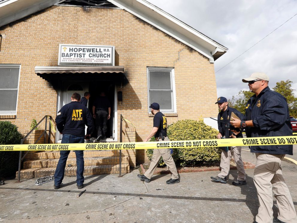 PHOTO: ATF agents gather outside the fire damaged Hopewell M.B. Baptist Church in Greenville, Mississippi, Nov. 2, 2016. Vote Trump was spray-painted on an outside wall of the black member church.