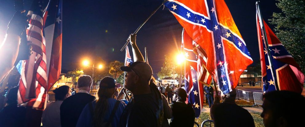 PHOTO: Demonstrators who supports keeping Confederate era monuments protest before the Jefferson Davis statue was taken down in New Orleans, May 11, 2017.