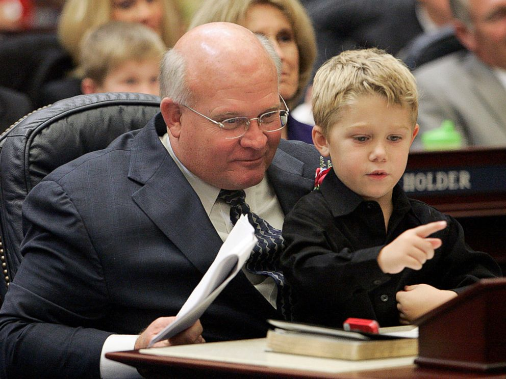 PHOTO: Here, then-Representative Baxley entertains his grandson in the Florida House of Representatives in Tallahassee, Fla., Nov. 21, 2006.
