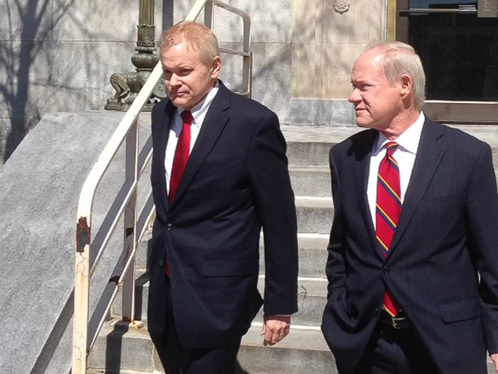 PHOTO: Eric C. Conn, left, walks out of a federal courthouse with defense attorney Joe Lambert on Tuesday, April 12, 2016, in Lexington, Ky., after being released on bond.