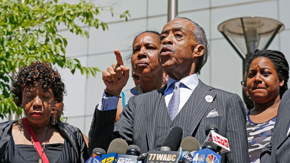 The Rev. Al Sharpton, second from right, gestures as he speaks to the media alongside members of Eric Garner's family, including Erica Garner, far right, after meeting with Department of Justice officials, Wednesday, June 21, 2017, in New York.