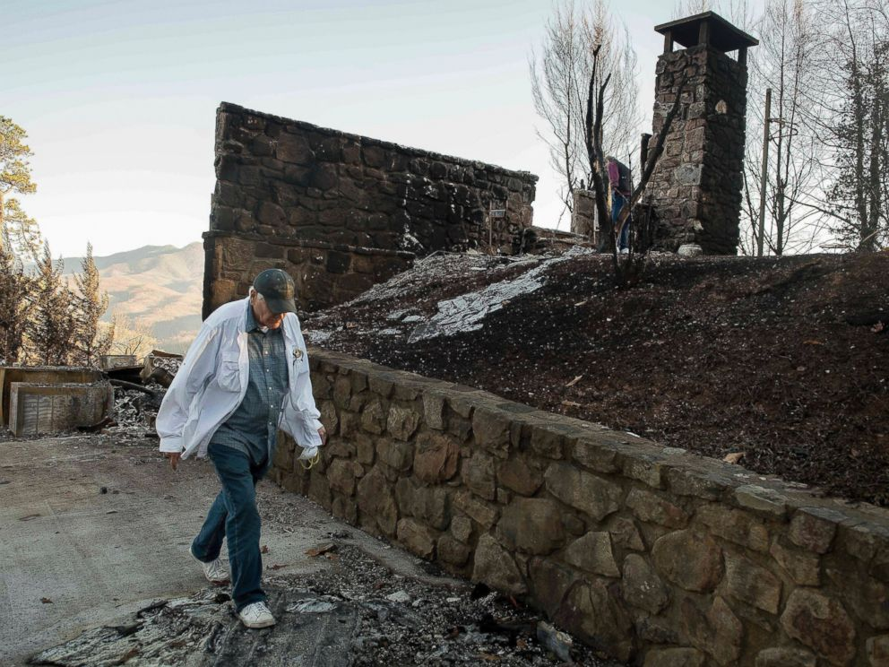 PHOTO: Richard T. Ramsey looks over the remains of the house that he had lived in for 41 years, Dec. 1, 2016, in Gatlinburg, Tennessee.