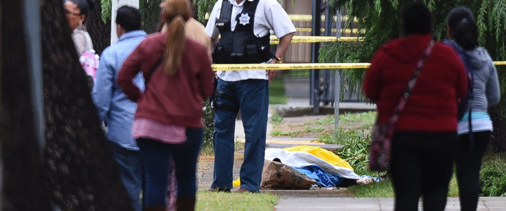 PHOTO: A Fresno police detective stands over the body of one of the three shooting victims, April 18, 2017 in Fresno, Calif.