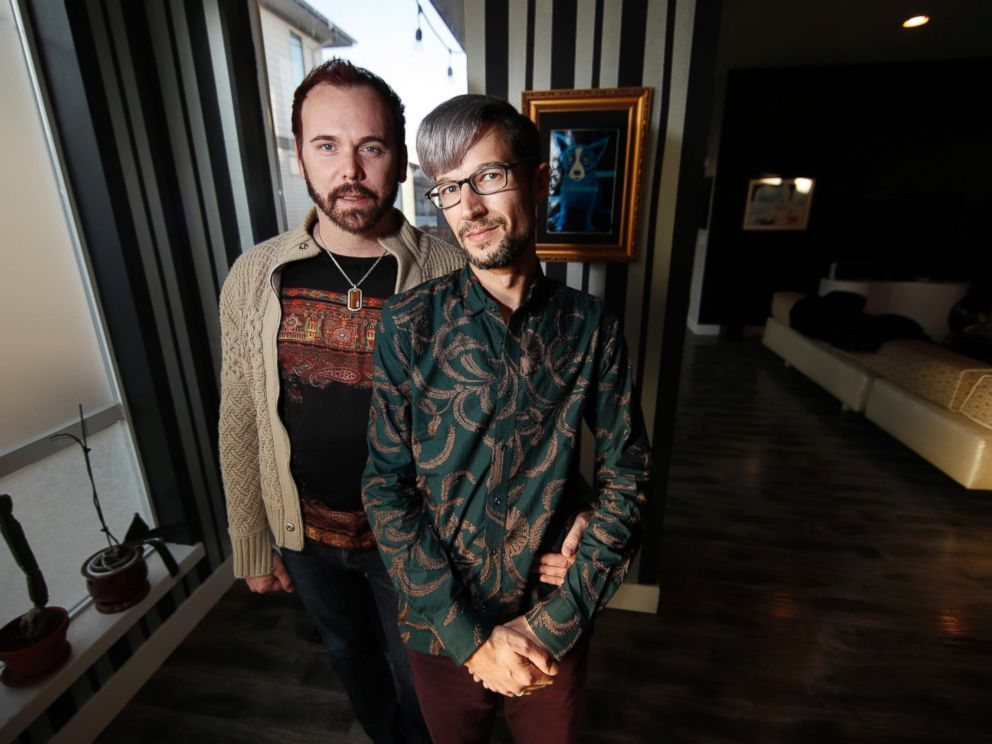 In this Tuesday, Nov. 28, 2017, photograph, Charlie Craig and David Mullins are shown in their home in Denver.