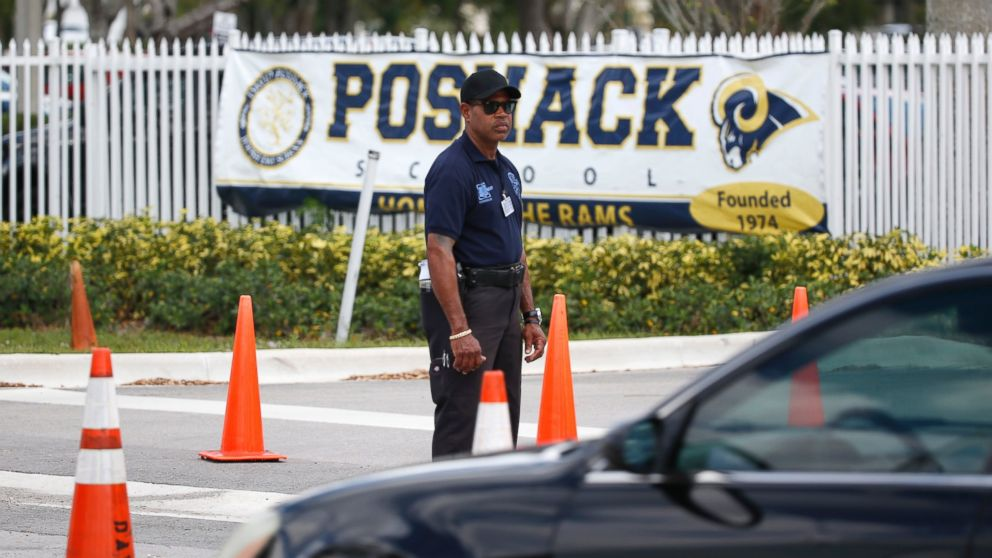 A security guard stands outside the entrance to the David Posnack Jewish Community Center and David Posnack Jewish Day School after people were evacuated because of a bomb threat, Feb. 27, 2017, in Davie, Fla.