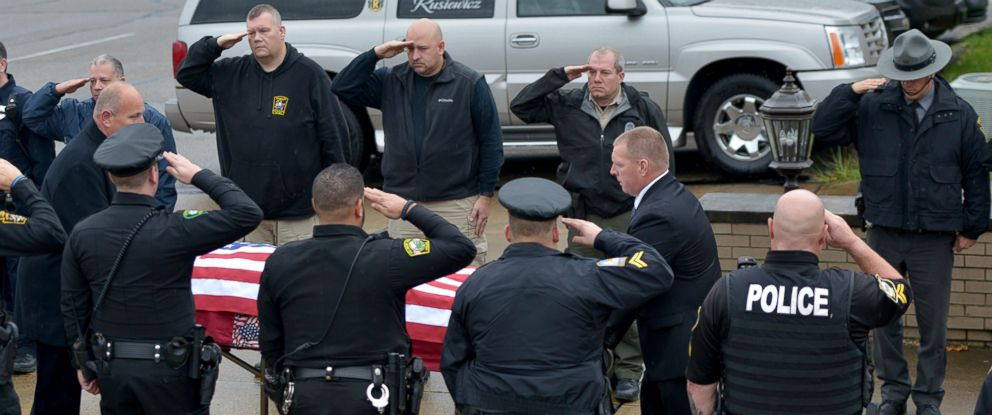 PHOTO: Members of area police departments salute the casket of New Kensington Police Officer Brian Shaw as it is moved into the Rusiewicz Funeral Home in Lower Burrell, Pa., Nov. 18, 2017.