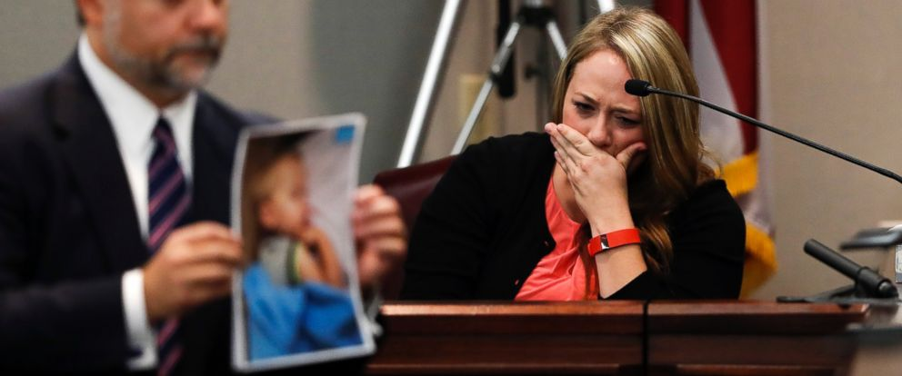 PHOTO: Leanna Taylor cries as defense attorney Maddox Kilgore shows the jury a picture of her son Cooper during a murder trial for her ex-husband Justin Ross Harris, Oct. 31, 2016, in Brunswick, Georgia.