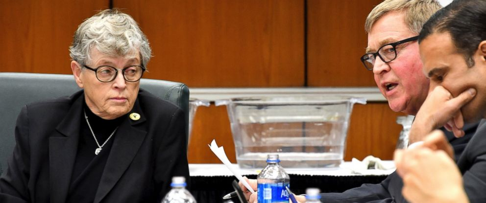 Michigan State President Lou Anna Simon looks on as Trustee Brian Breslin addresses the board and onlookers at the board of trustees meeting Friday morning, Dec 15, 2017, in East Lansing, Mich.
