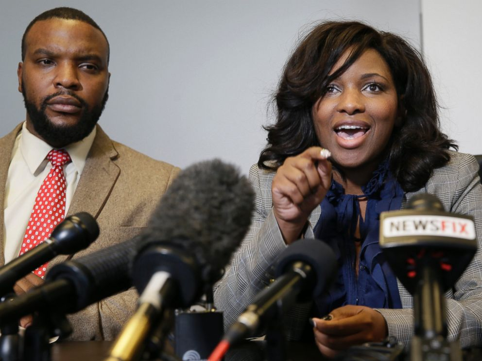 PHOTO: Attorney Jasmine Crockett, right, speaks while her law partner attorney Lee Merritt listens during a news conference in Dallas, Thursday, Jan. 26, 2017.