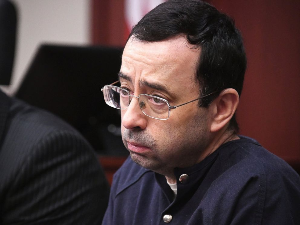 Larry Nassar looks at the gallery in the court during the sixth day of his sentencing hearing Tuesday, Jan. 23, 2018, in Lansing, Mich. Nassar has admitted sexually assaulting athletes when he was employed by Michigan State University and USA Gymnastics.