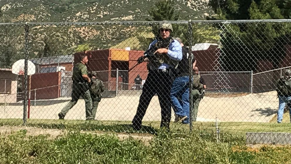 Emergency personnel respond to a shooting inside North Park School Elementary School, April 10, 2017, in San Bernardino, Calif.