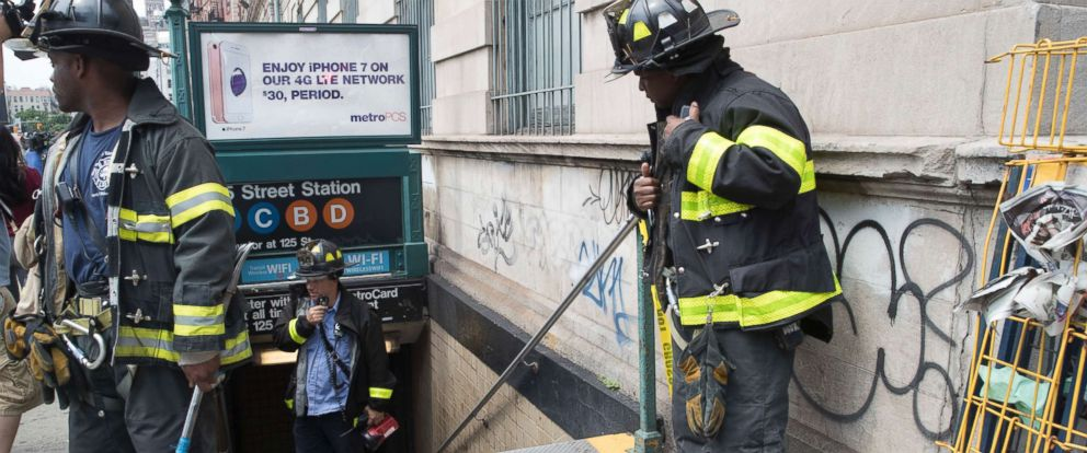 PHOTO: Emergency service personnel work at the scene of a subway derailment, Tuesday, June 27, 2017, in the Harlem neighborhood of New York.
