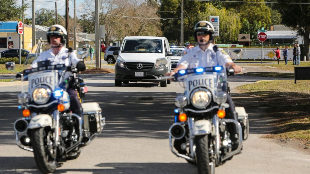 Law enforcement officers escort the body of the Orange County deputy that died in the line of duty on Monday to the Orange County Medical Examiner's Office on Jan. 9, 2017.