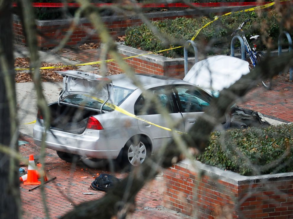 PHOTO: A car inside a police line sits on the sidewalk as authorities respond to an attack on campus at Ohio State University, Monday, Nov. 28, 2016, in Columbus, Ohio.