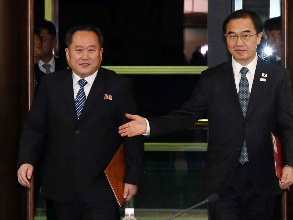 South Korean Unification Minister Cho Myoung-gyon, right, and the head of North Korean delegation Ri Son Gwon arrive at a meeting at the Panmunjom, South Korea, Tuesday, Jan. 9, 2018. Ri will attend the Olympics closing ceremony on Sunday, Feb. 25, 2018.