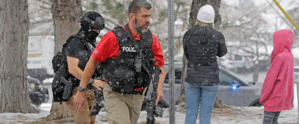 PHOTO: Police officers carry their weapons in front of Mueller Park Junior High after a student fired a gun into the ceiling Thursday, Dec. 1, 2016, in Bountiful, Utah.