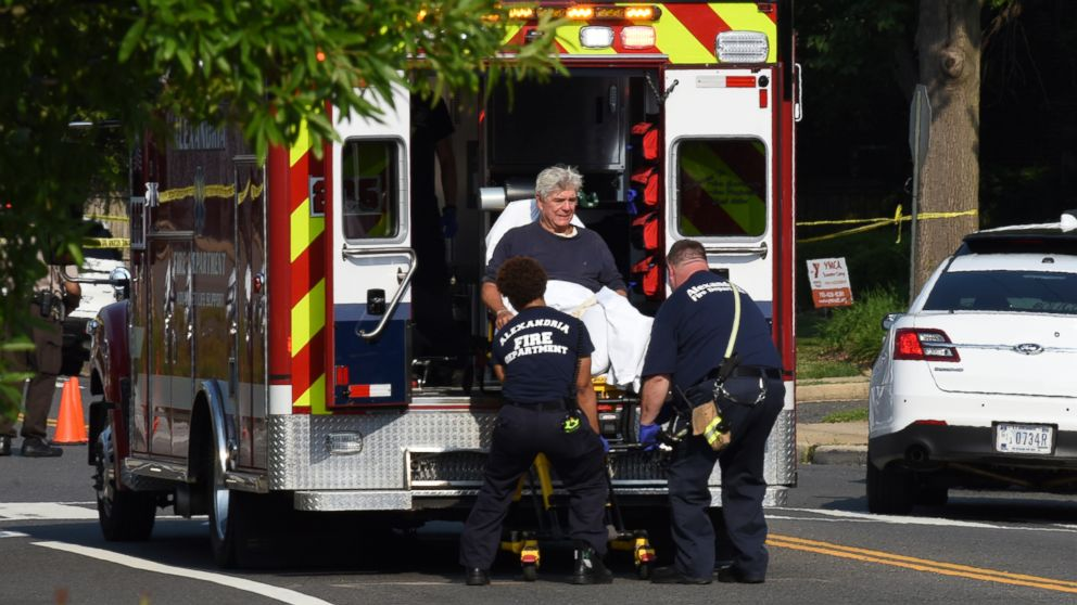 Rep. Roger Williams is placed into an ambulance at the scene of a shooting at a baseball field in Alexandria, Va., June 14, 2017.