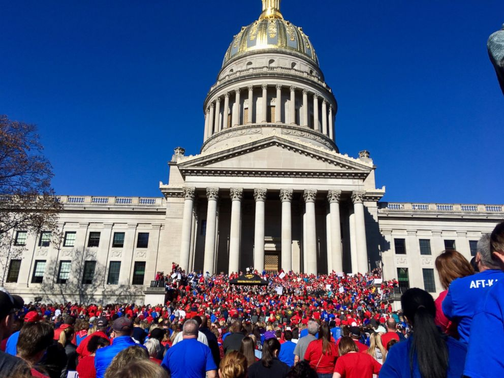 Thousands of West Virginia teachers attend a rally at the state Capitol in Charleston, W.Va., Monday, Feb. 26, 2018. Teachers across West Virginia will continue a walkout over pay and benefits for a fourth day.