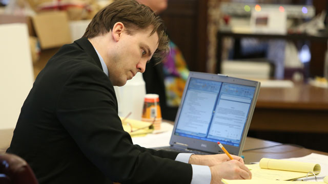 PHOTO: Brett T. Seacat writes on a note pad during the the State v. Brett T. Seacat trial, Kingman, Kan. May 31, 2013.