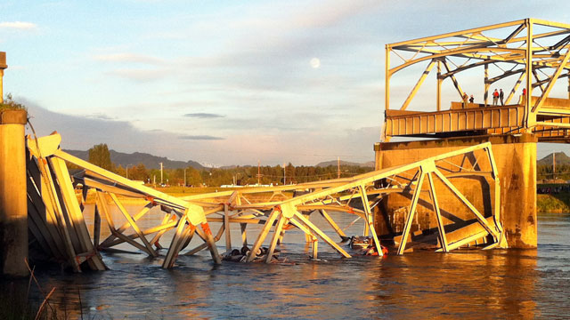 PHOTO: A portion of the Interstate 5 bridge is submerged after it collapsed into the Skagit River dumping vehicles and people into the water in Mount Vernon, Wash., Thursday, May 23, 2013.