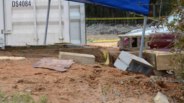 PHOTO:In this undated photo released by the FBI on Tuesday, Feb. 5, 2013, a tent covers the bunker where where a 5-year-old child was held for a week by Jimmy Lee Dykes in Midland City, Ala.