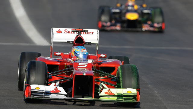 PHOTO: Ferrari driver Fernando Alonso of Spain leads Red Bull driver Sebastian Vettel of Germany into turn one during the first free practice session for the Formula Ones U.S. Grand Prix at the Circuit of the Americas, Nov. 16, 2012, in Austin, Texas.