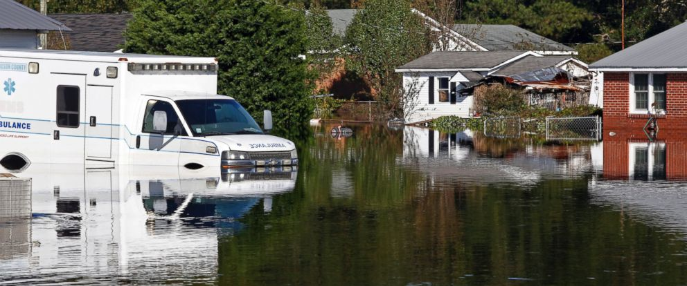 PHOTO: Floodwaters associated with Hurricane Matthew surround homes and an ambulance, Oct. 13, 2016, in Lumberton, North Carolina.