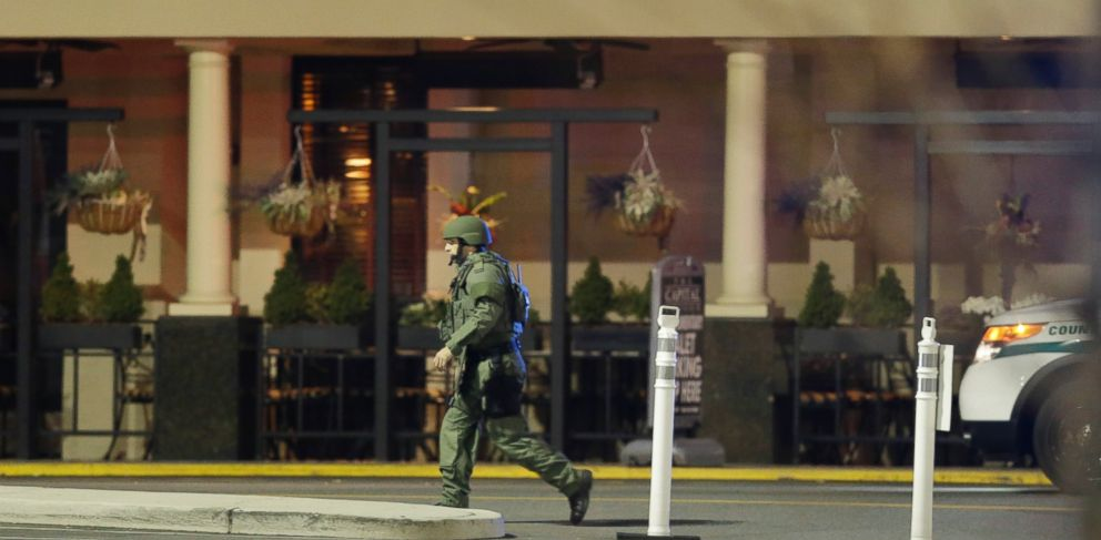PHOTO: An official wearing tactical gear walks outside of Garden State Plaza Mall following reports of a shooter, Monday, Nov. 4, 2013, in Paramus, N.J.