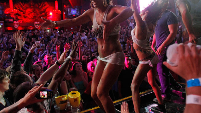 PHOTO: Spring break revelers dance on a stage during a wet T-shirt contest at a nightclub in the resort city of Cancun, Mexico, on March 12, 2013.