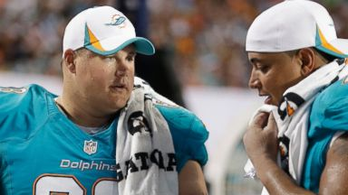 PHOTO: Miami Dolphins Richie Incognito (68) and Jonathan Martin (71) look over plays during the second half of an NFL preseason football game against the Tampa Bay Buccaneers, Aug. 24, 2013, in Miami Gardens, Fla.