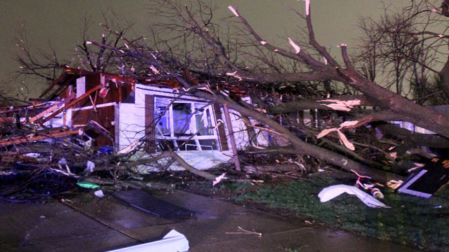PHOTO:A tree fell on a home on Lynn Haven Lane in Hazelwood, Missouri during a storm that caused extensive damage to homes and businesses on Wednesday, April 10, 2013.