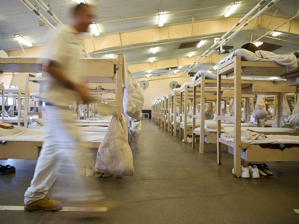 PHOTO: A prisoner walks near his crowded living area in Elmore Correctional Facility in Elmore, Ala., June 18, 2015.