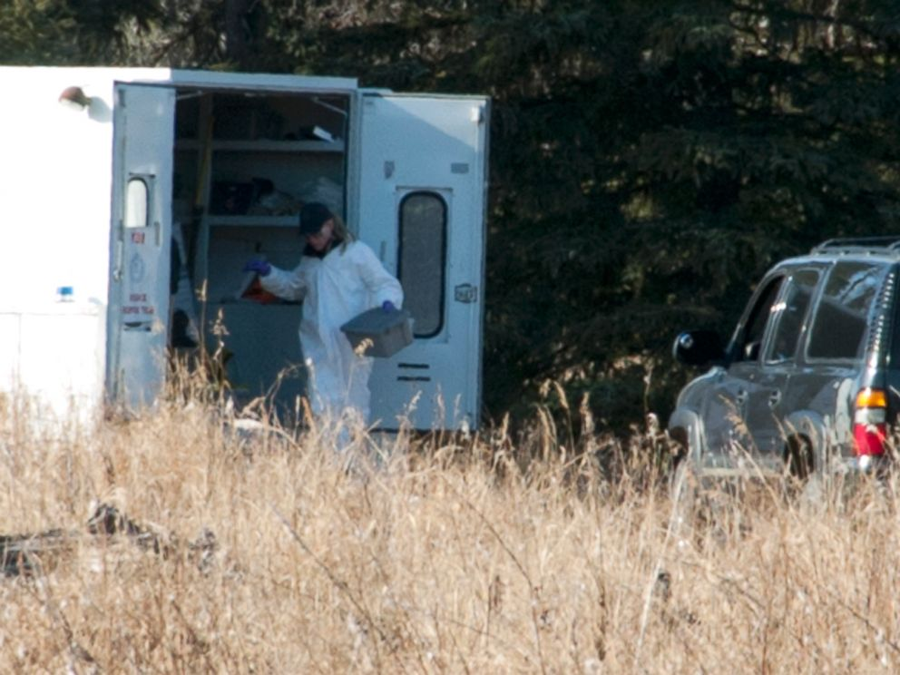 PHOTO: Investigators set up a temporary facility between Alpine Drive and Borgen Avenue, March 22, 2015, after finding human remains that could be a family from Kenai, Alaska.