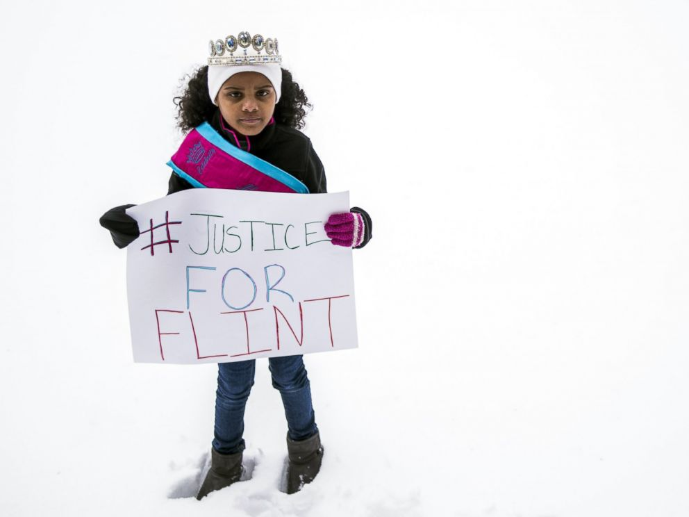 PHOTO: In a March 6, 2016 photo, Mari Copeny, 8, of Flint, Mich., stands with a protest sign during a #Justice4Flint rally at Wilson Park on University of Michigan-Flints campus in Flint, Mich.