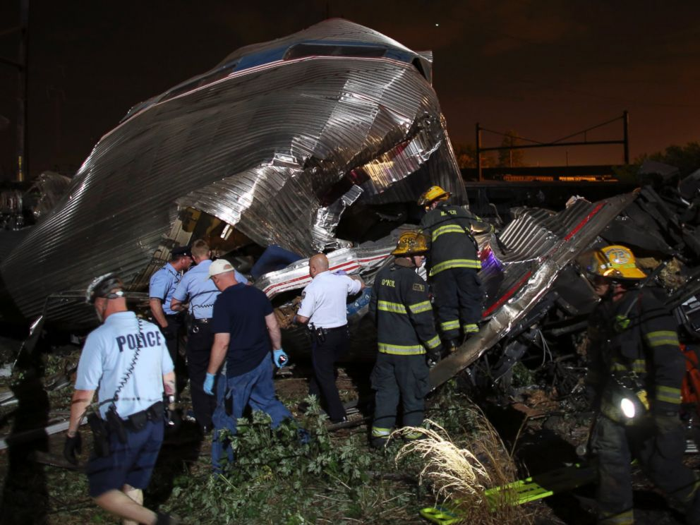 PHOTO: Emergency personnel work the scene of a train wreck, May 12, 2015, outside Philadelphia.