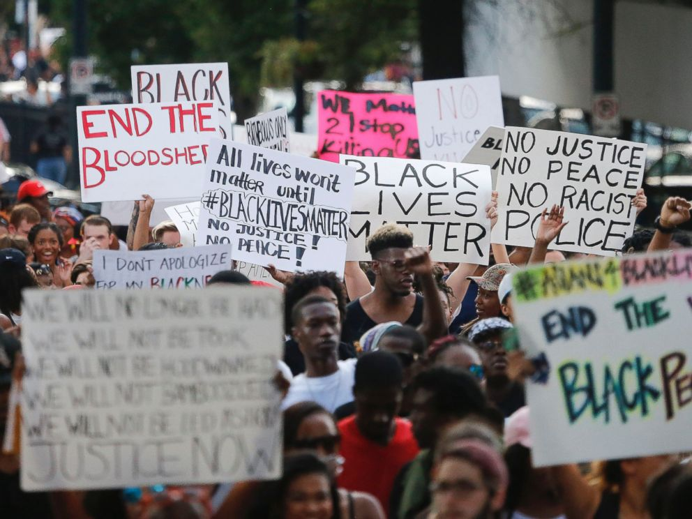PHOTO: Demonstrators march through downtown Atlanta to protest the shootings of two black men by police officers, Friday, July 8, 2016.