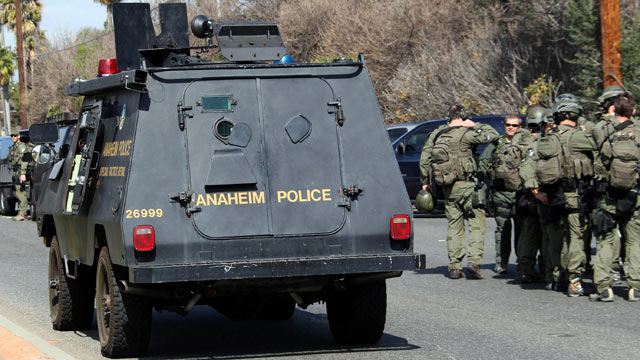 PHOTO: An Anaheim Police armored car and FBI SWAT team members are gathered near the perimeter of a bank standoff where a gunman is holding a bank manager hostage on March 1, 2012, in Buena Park, Calif.